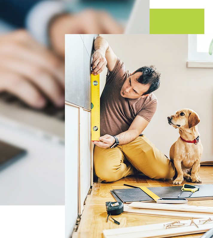 Man is measuring the dimensions inside his new building, preparing for construction with his dog sitting beside him
