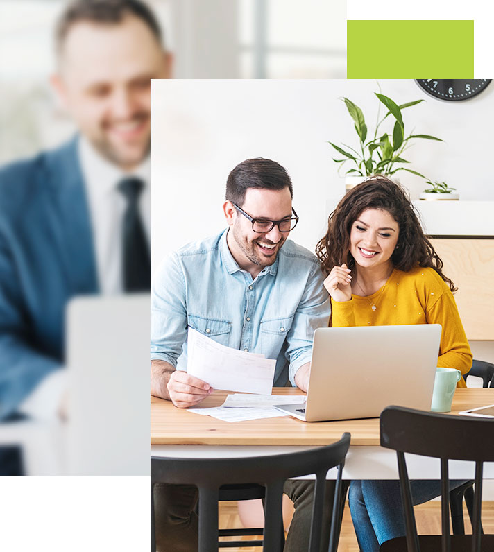 couple smiling at computer, realizing how easy and helpful the mortgage calculator is