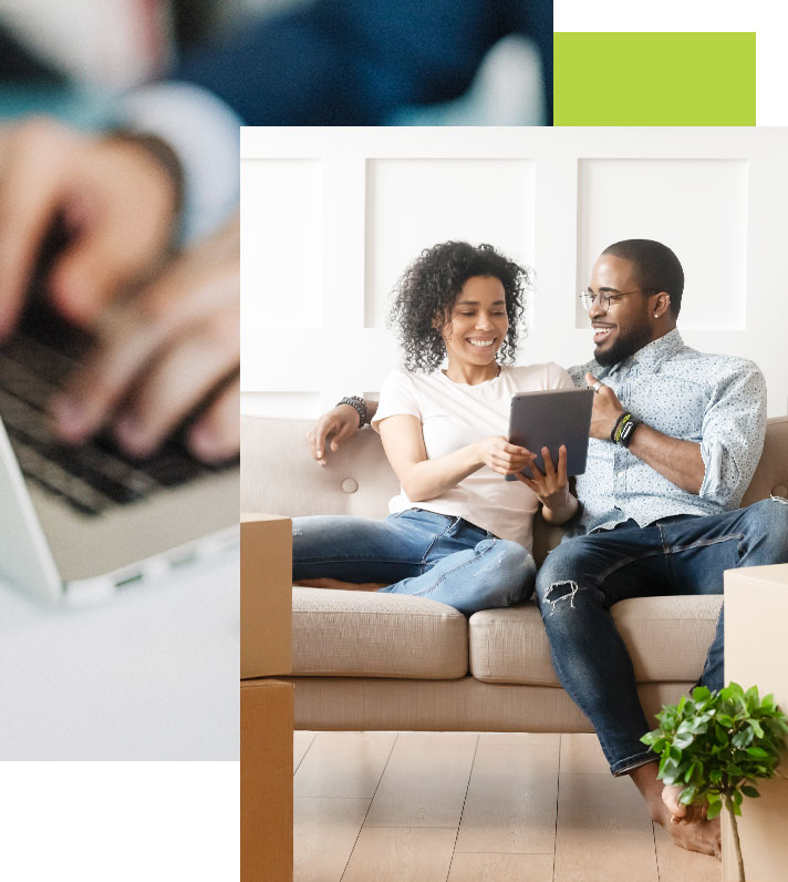 Couple smile at each other as they review their purchase mortgage on the couch